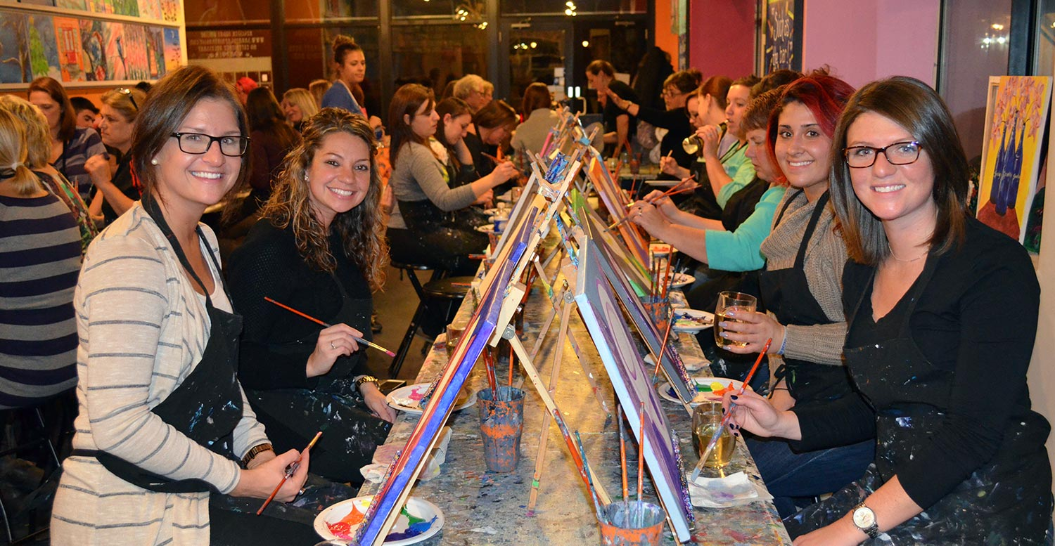 a group of women at the Paint & Sip Studio!