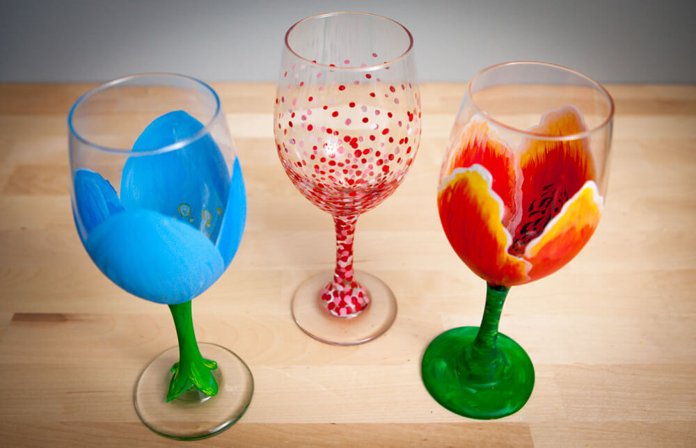 three painted wine glasses